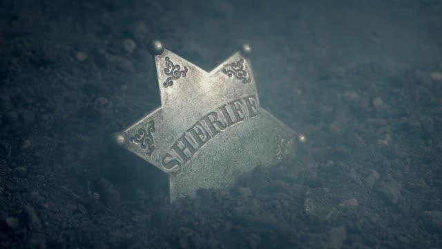 Wild West Sheriff Badge On Ground With Smoke