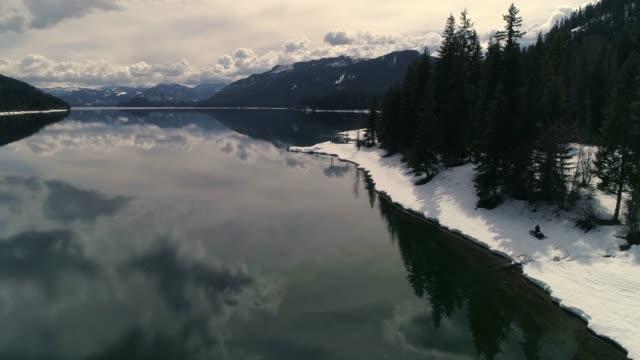 Wilderness Snowmobile Adventure on Edge of Lake video