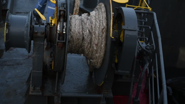 Winch with rope on ferry,rope is holding ferry when anchored in the docks.