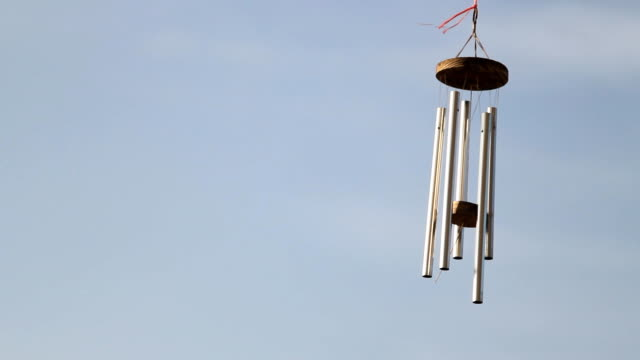 wind chime tube mobile. wind chime tube mobile, blue sky background us coin stock videos & royalty-free footage