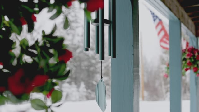 Wind Chimes at the entrance of an American Holiday Home in Vermont B-Roll, Vermont, Snowfall, Weather, Nature, US Flag, Wind Chimes, Home - North American Winter chalet stock videos & royalty-free footage