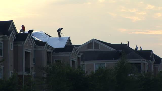 wind damaged roofs - yttertak bildbanksvideor och videomaterial från bakom kulisserna