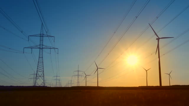 Wind energy and High Voltage Tower - sunset video