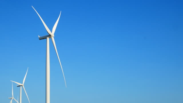 wind energy turbines are one of the cleanest, renewable electric energy source. electricity is generated by electric generators hidden inside turbine - turbina a vento video stock e b–roll