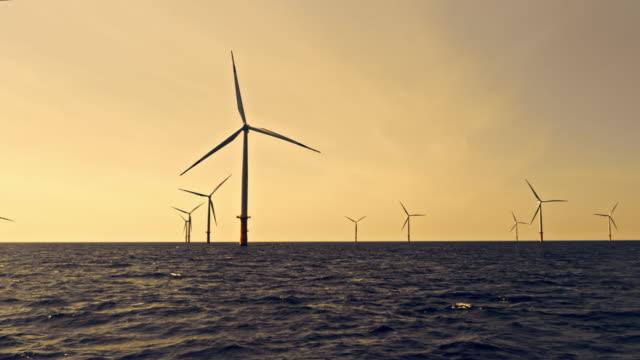 aerial wind farm at sea in setting sun - danimarca video stock e b–roll
