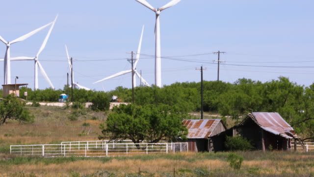 Wind Farm Turbines Turn Over Old Barn in Rural Texas - Close Up