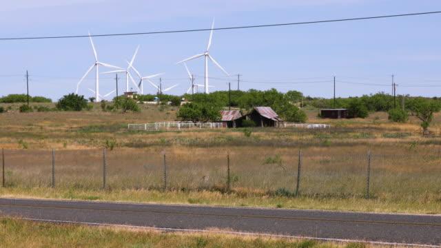 Wind Farm Turbines Turn Over Old Barn in Rural Texas