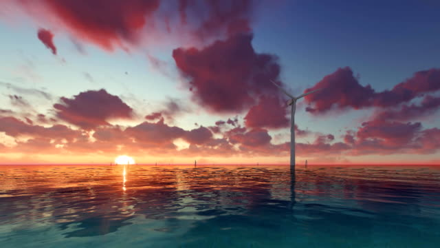 Wind generator at sunset on sea Wind generator at sunset on sea and boats high dynamic range imaging stock videos & royalty-free footage