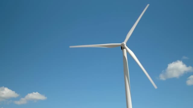 Wind generator on bright cloudy sky background Wind generator on bright cloudy sky background propeller stock videos & royalty-free footage