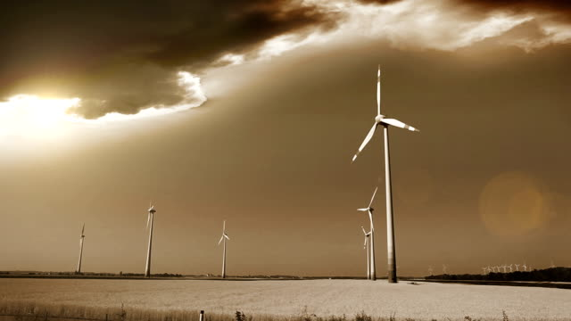 Wind generators in the fields of Austria, apocalyptic sky on the background video