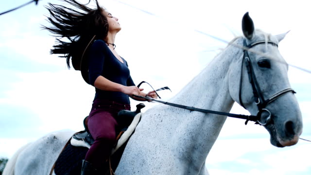 Wind in my hair and smile on my face 27 years old woman is ready to ride a horse. She loves to spend her free time with her horse cowgirl stock videos & royalty-free footage