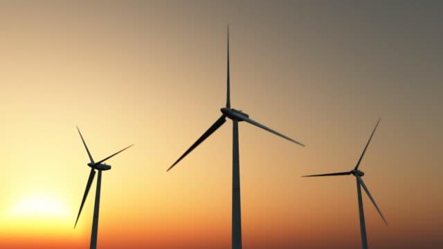 vídeos de stock e filmes b-roll de energia eólica ao pôr do sol - três objetos