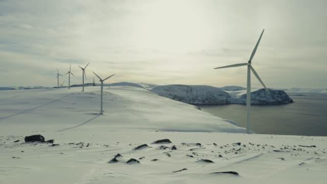 wind power sustainable resource in the arctic - дистанционный стоковые видео и кадры b-roll