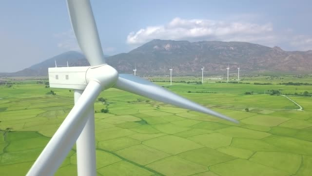 Wind power turbines aerial landscape. Windmill turbine generating clean renewable energy in green agricultural field drone view. Wind energy station. Ecology and nature conservation Wind power turbines aerial landscape. Windmill turbine generating clean renewable energy in green agricultural field drone view. Wind energy station. Ecology and nature conservation windmill stock videos & royalty-free footage