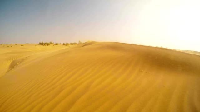 wind raises cloud of sand in desert thar dunes blue sky rajasthan