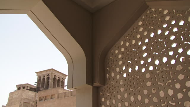 Wind Tower, Dubai Wind Tower, Dubai. View of a traditional wind tower seen from the Bastakiya mosque courtyard. Wind towers create natural ventilation in buildings. dubai architecture stock videos & royalty-free footage