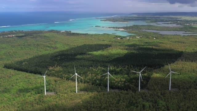 wind turbine fields working on the windy coastline - isole mauritius video stock e b–roll