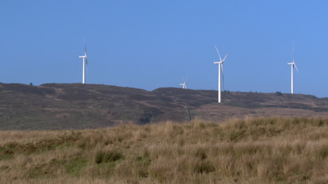 Wind turbine in remote rural Scottish location 4k footage shot at 50fps and interpreted at 25 fps to give slower motion galloway scotland stock videos & royalty-free footage