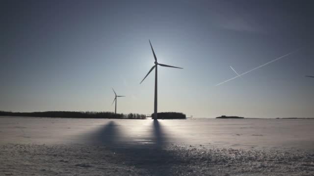 Wind Turbine Silhouette and Shadow