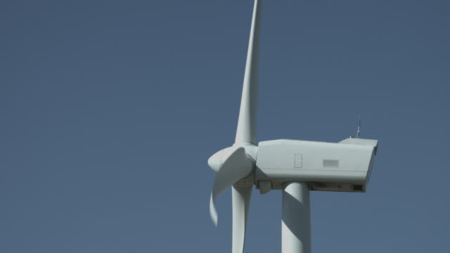 Wind Turbine Spinning Against Clear Blue Sky video
