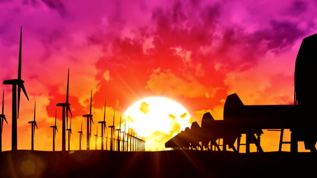 Wind turbines and oil pumps at sunset video