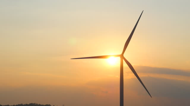 wind turbines at sunset, renewable energy - turbina a vento video stock e b–roll