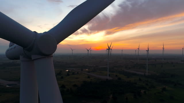 Wind turbines farm - Energy Production with clean and Renewable Energy - 4k  aerial shot video
