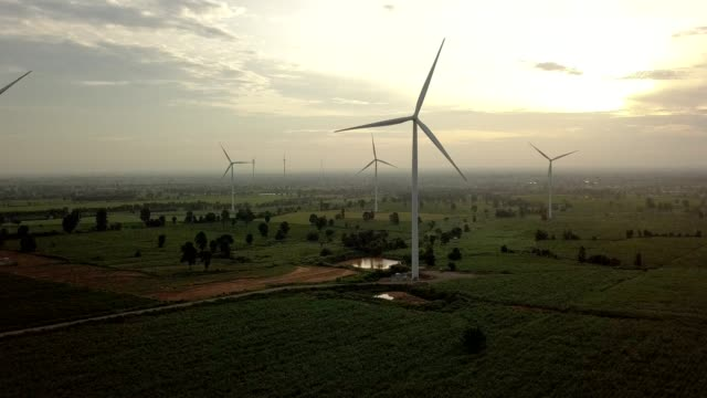 Wind turbines generating electricity. energy conservation concept video