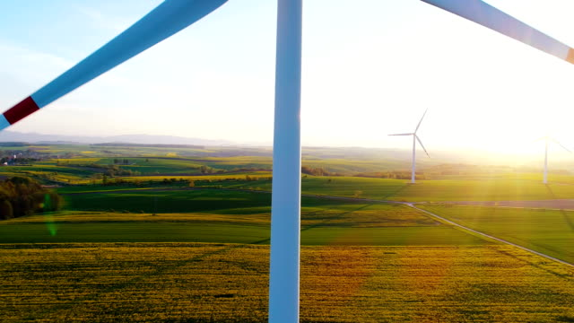 wind turbines in agricultural fields - turbina a vento video stock e b–roll