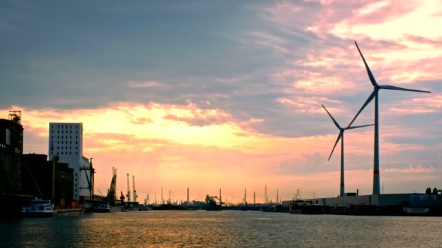 wind turbines in antwerp port on sunset. - belgio video stock e b–roll