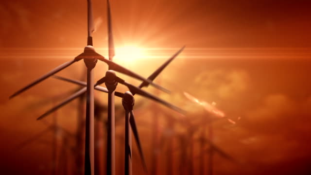 Wind turbines in field at sunset video