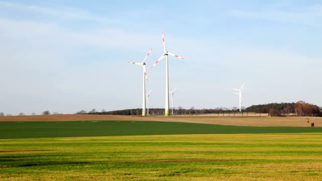 Wind Turbines in slowly rotating video