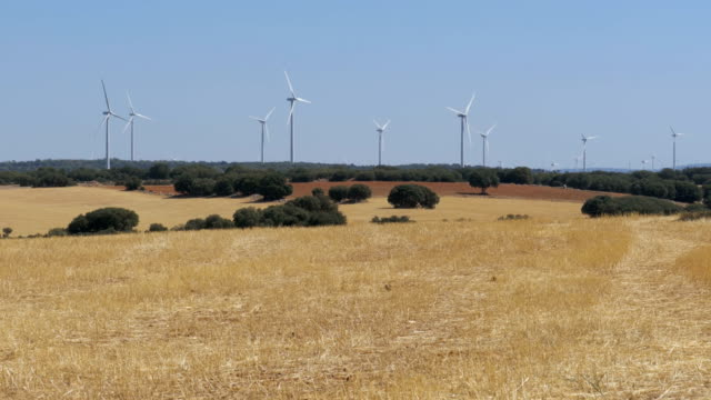 Wind Turbines in the Desert of Spain Wind Turbines in the Desert of Spain. Massive wind turbines generating power. Heat haze effect on desert land. Clean Energy producing of Windmills. Alternative power generation methods heat haze stock videos & royalty-free footage