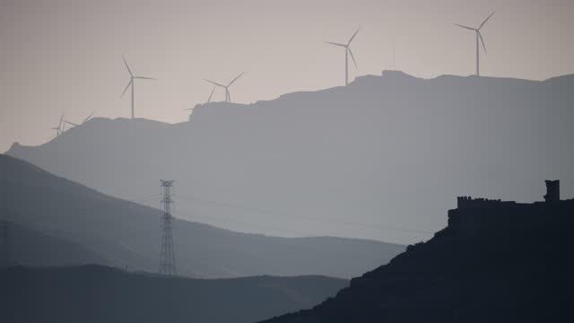 Wind turbines power generator farm in mountains video