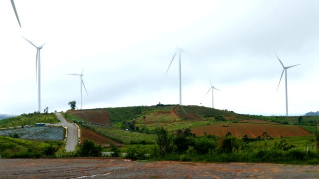 Wind turbines producing clean alternative energy in the mountains video