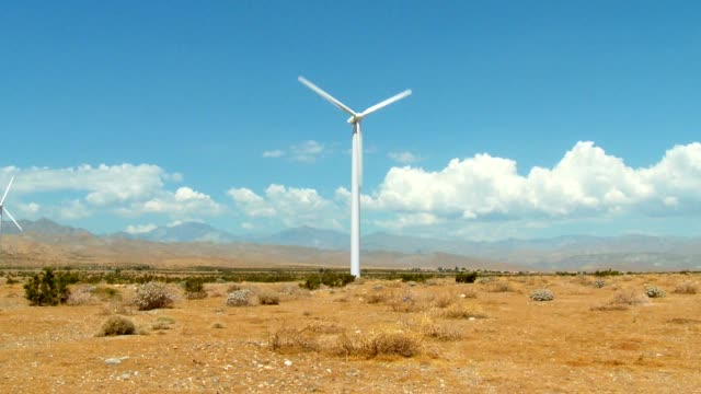 windmill cloud and desert timelapse video