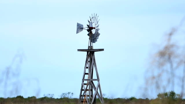 Windmill in the desert Windmill in the desert wild west stock videos & royalty-free footage