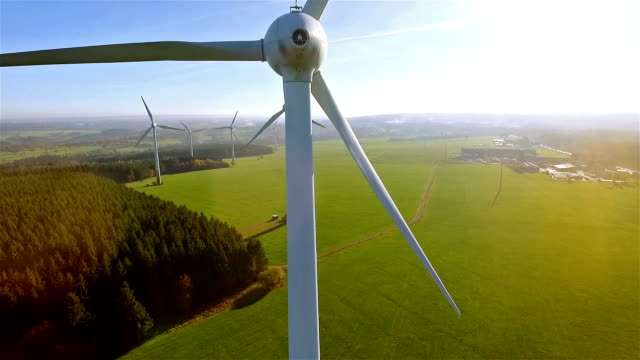 windmill / wind power technology - aerial drone view on wind power park - sustainability video stock e b–roll