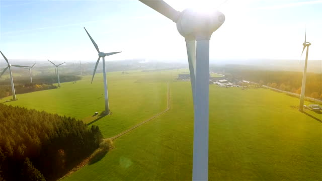 windmill / wind power technology - aerial drone view on wind power park - энергия ветра стоковые видео и кадры b-roll