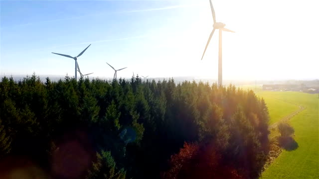 windmill / wind power technology - aerial drone view on wind power park - turbina a vento video stock e b–roll