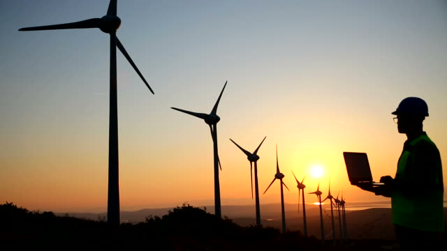 Windmills and engineer Windmills and engineer wind power stock videos & royalty-free footage