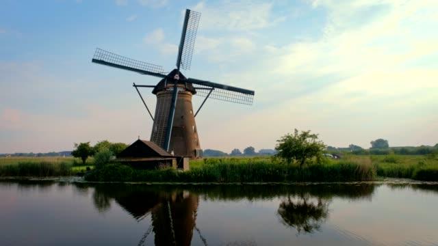 Windmills at Kinderdijk in Holland. Netherlands Netherlands rural village scenic view - windmills at famous tourist site Kinderdijk in Holland. Kinderdijk , Netherlands netherlands stock videos & royalty-free footage