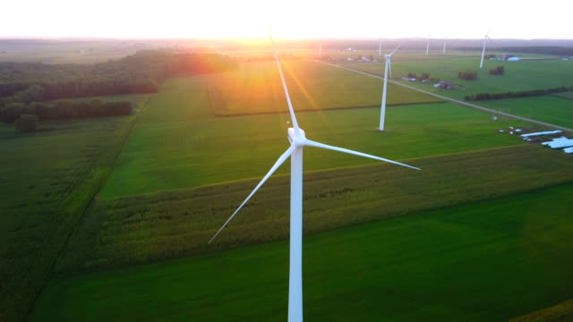 Windmills at sunset turning slowly in the calm video