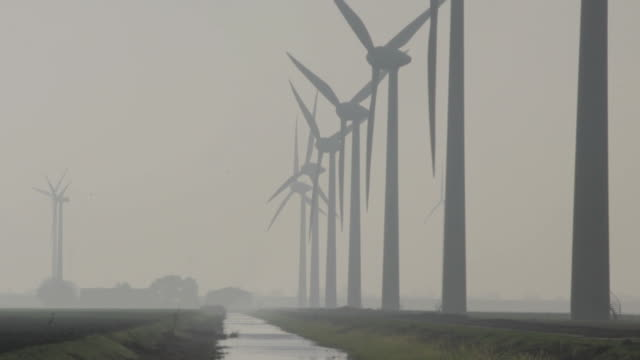 Windmills in a row, wideangle Windmills in action homegrown produce stock videos & royalty-free footage