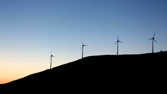 Windmills in movement at sunset. Kefalonia. Ionian islands. Greece. Europe video