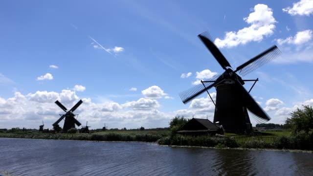 windmills turning in sunny weather in Kinderdijk video
