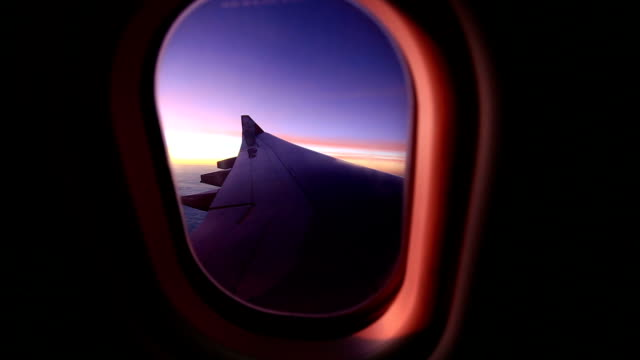 Window airplane Travel time is sunset. video
