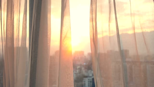 window curtain with morning sunlight - bedroom video stock e b–roll