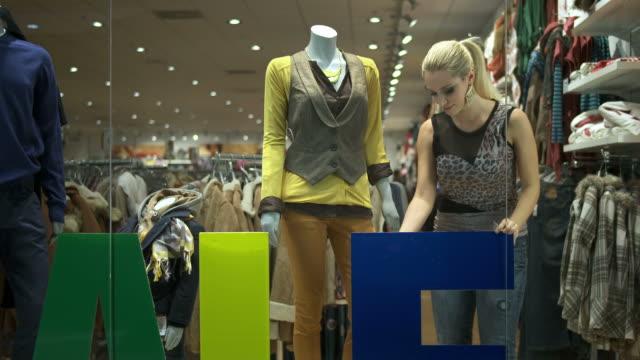 HD DOLLY: Window Dresser Arranging The Shop video