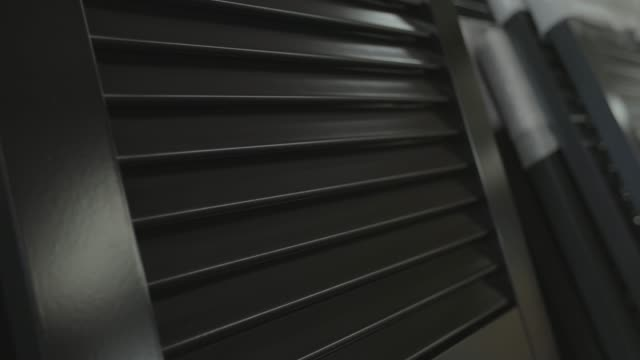 Window shutters in a warehouse video